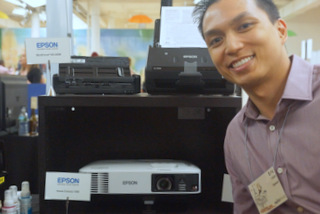 Epson's Eric Uaje with Home Cinema 1450 (Techstination photo by L. Fishkin)